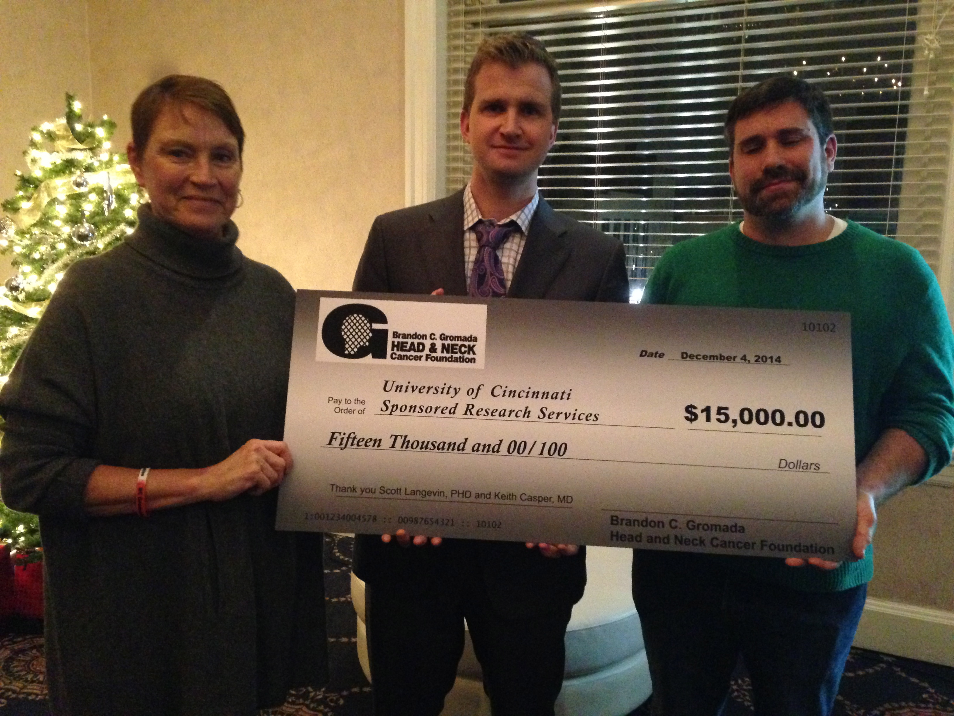 Ceremonial Grant Award Check Presented to UC Researchers